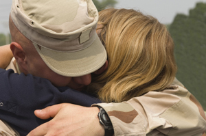 military couple embrace