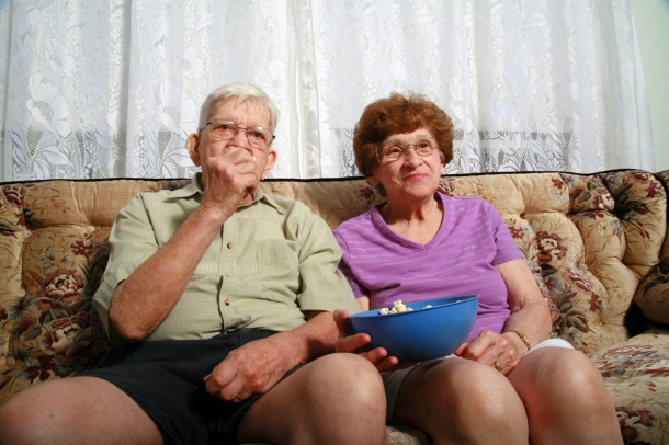 Older couple eating popcorn
