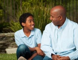 Father and son confiding