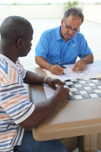 Juan Garcia helps Veteran during Operation Sacred Trust Intake in Miami