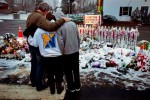 Members of the Rutter family of Newtown, Conn., embrace early Christmas morning as they stand near memorials by the Sandy Hook firehouse (AP Photo/Craig Ruttle)