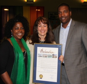 Dade County Deputy Mayor Russell Benford presents proclamation to Carrfour CEO Stephanie Berman-Eisenberg