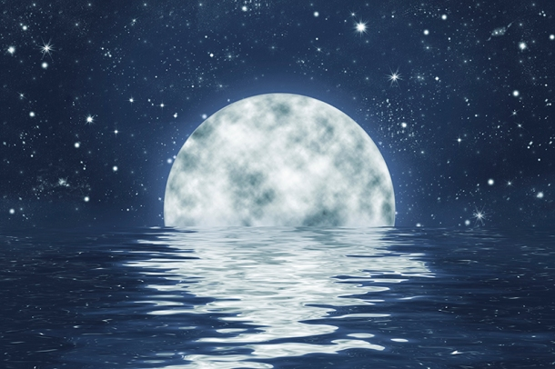 Moon over water amidst the stars of an evening sky.